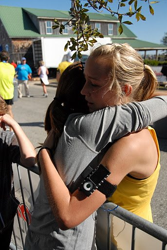 Getting a hug from my friend after crossing the finish of my first 26.2. Almost in tears.