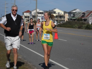 "My Dad running alongside me and coaching me through mile 18ish at Outer Banks Marathon. Notice how I am giving him a bratty look like, ""Why are you running in jeans in a vest?"""