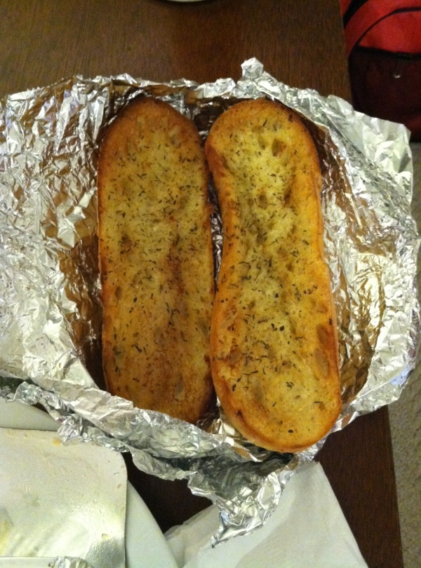 I'm pretty sure they said a SIDE of garlic bread. Not an entire loaf. No complaints.